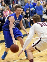 White House High junior guard Bradley Cole dribbles to the basket as Cheatham County senior Austin Douglas defends. Cole scored a team-high 22 points.