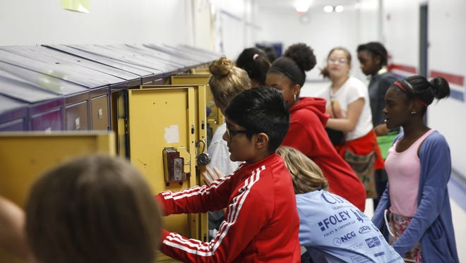 Students gather supplies from their lockers, in between class at Fairview Middle School.