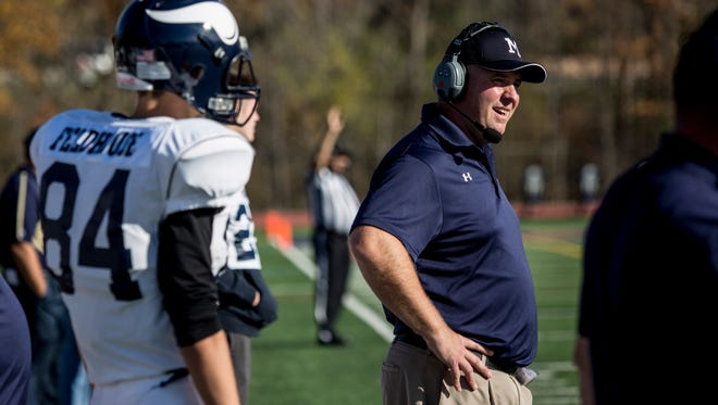 Marysville coach Mark Caza watches from the sidelines during a district football game Saturday, Nov. 5, 2016 at Detroit Country Day High School.