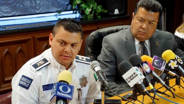 New Juárez police chief Ricardo Realivazquez and Mayor Armando Cabada speak to the news media.