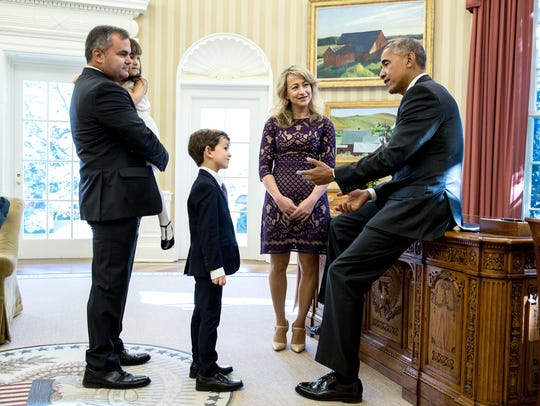 President Barack Obama meets with Alex Myteberi, 6-year-old