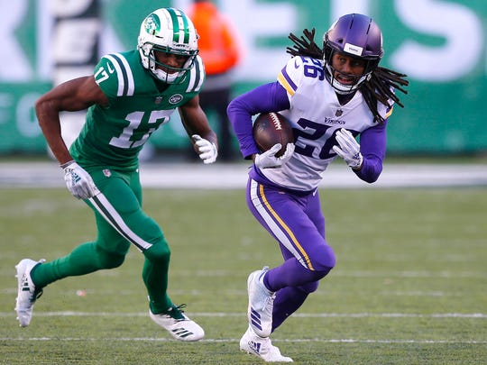 Oct 21, 2018; East Rutherford, NJ, USA; Minnesota Vikings cornerback Trae Waynes (26) runs from New York Jets wide receiver Charone Peake (17) after making an interception during the second half at MetLife Stadium. Mandatory Credit: Noah K. Murray-USA TODAY Sports