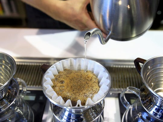 A Brazilian Natural pour over is prepared on Monday, June 20, 2016, at Bloom Coffee Works located inside the H-E-B in Portland.