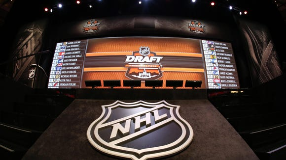 Jun 27, 2014; Philadelphia, PA, USA; A general view of the complete draft board after the completion of the first round of the 2014 NHL Draft at Wells Fargo Center. Mandatory Credit: Bill Streicher-USA TODAY Sports