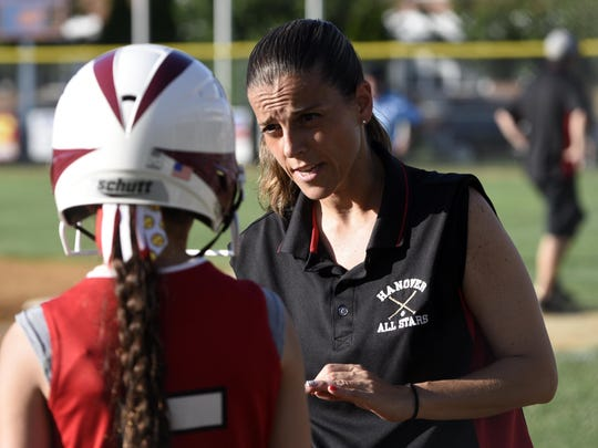 Hanover coach Maria Mess talks to player Evelyn Dente before her at-bat in the first inning of Thursday night's game.