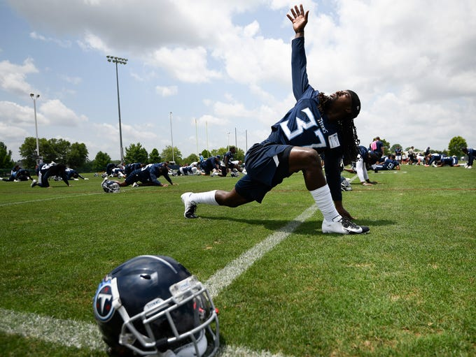 Titans safety Johnathan Cyprien (37) stretches during