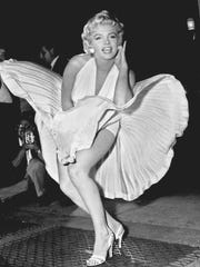 """Marilyn Monroe poses over the updraft of New York subway grating while in character for the filming of """"The Seven Year Itch"""" in 1954."""
