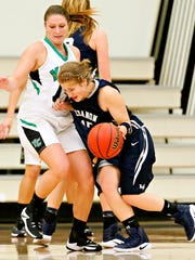 Lebanon Valley's Becky Evans, right, looks to get around