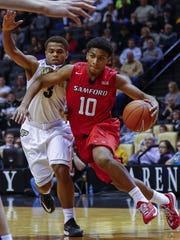 Christen Cunningham (10) drives with the ball against Purdue during his time at Samford.