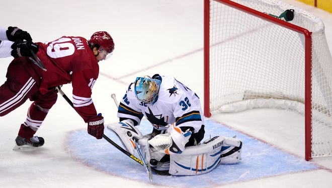 San Jose Sharks goalie Alex Stalock (32) makes a save on Phoenix Coyotes right wing Shane Doan (19) during the third period at Jobing.com Arena.