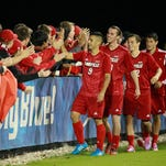 UofL's Soccer team greet fans who came to watch their match against the University of Kentucky, Tuesday, Sept. 23, 2014 at UK Soccer Complex in Lexington. Photo by Jonathan Palmer, Special to the CJ