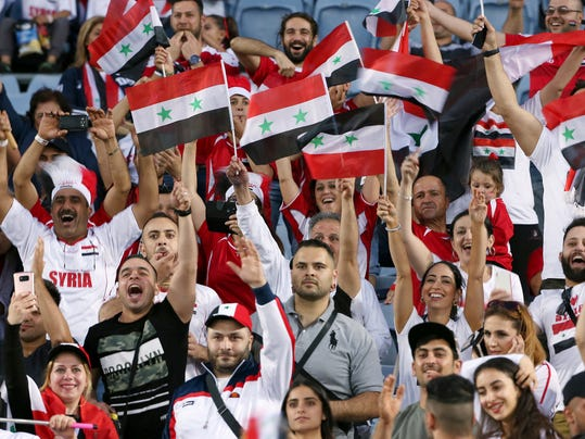 Syria fans cheer before the start of the Soccer World Cup qualifying match between Australia and Syria in Sydney, Australia, Tuesday, Oct. 10, 2017. (AP Photo/Rick Rycroft)
