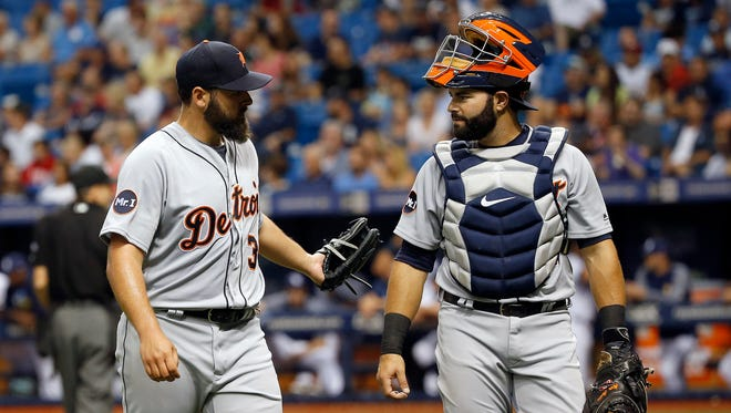 Tigers starting pitcher Michael Fulmer (32) and catcher Alex Avila (31) talk at the end of the second inning Tuesday in St. Petersburg, Fla.