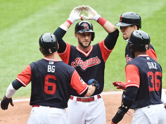 Yan Gomes, center, celebrates with Indians teammates