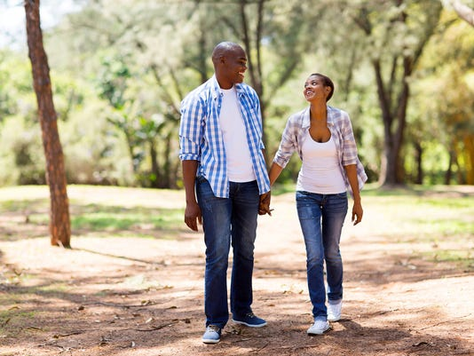 african couple enjoying a walk