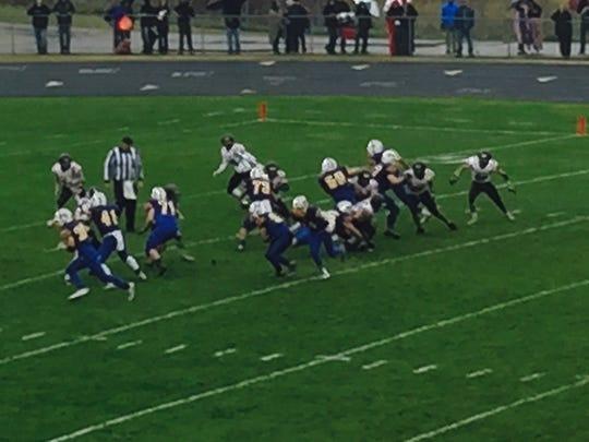 St. Michael-Albertville runs the ball against the St. Cloud Tech defense in the third quarter Saturday.
