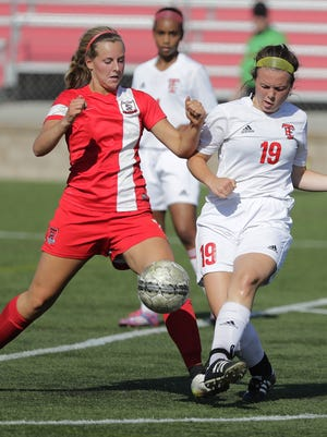 Pulaski's Nicole Mooren blocks a shot attempt by Wauwatosa East's Emma Martin (19) in a Division 2 semifinal at the WIAA state girls soccer tournament Friday at Uihlein Soccer Park in Milwaukee.