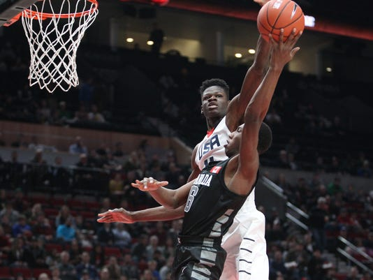 Team USA's Mohamed Bamba blocks a shot by World Select Team's R.J. Barrett  during the Nike Hoop Summit basketball game in Portland, Ore., Friday, April 7, 2017. (Pete Christopher/The Oregonian via AP)