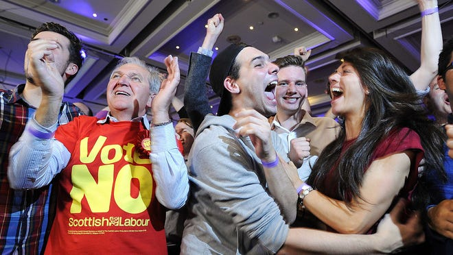 """Pro-union supporters celebrate as Scottish independence referendum results were announced at a """"Better Together"""" event in Glasgow, Scotland, on Friday. Scotland voted 55 percent to 45 percent to reject independence."""