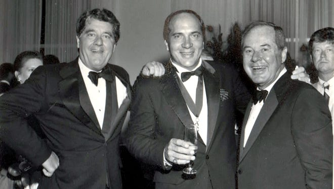 Michael Comisar (left) poses with Reds great Johnny Bench (middle) and Lee Comisar.