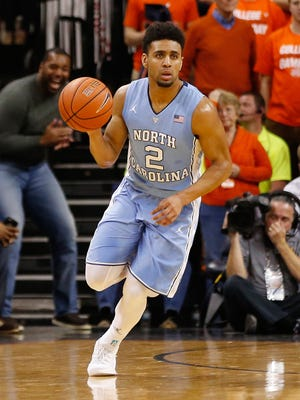 North Carolina Tar Heels guard Joel Berry II (2) dribbles the ball against the Virginia Cavaliers at John Paul Jones Arena.