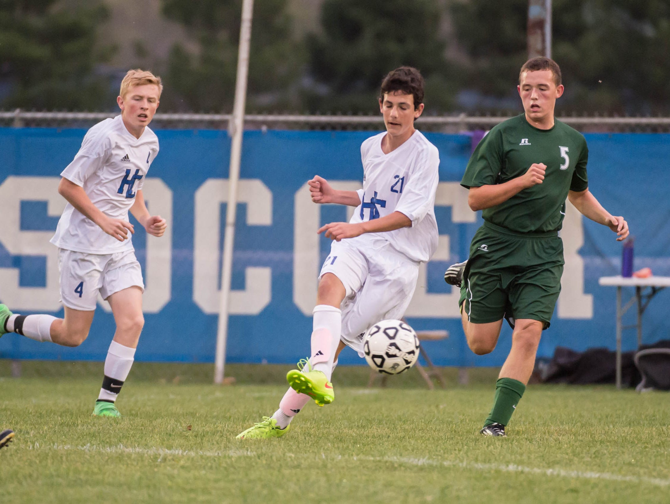 Harper Creek's Diego Subiza advances the ball (21) during district action Tuesday evening.