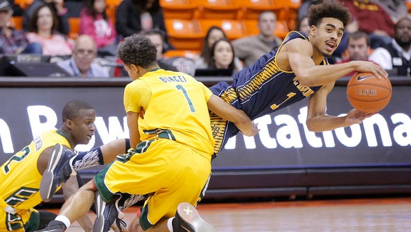 UC Irvine's Alex Young looks to pass as he is tackled