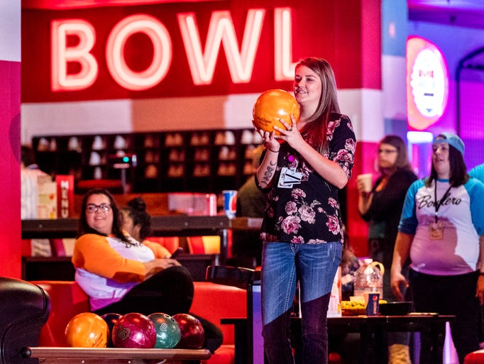 Dani Antes prepares to throw as employees bowl at the