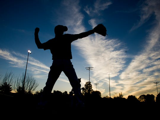 Grant Okes, 14, of Evansville, an outfielder for the Southern Indiana Shockers, warms up on the Mickey Martin baseball field at McCutchanville Community Park in Evansville,  Thursday, Oct. 13, 2016. The Mickey Martin baseball field could be in jeopardy as the Evansville Vanderburgh School Corp. finalizes plans for a new North Side elementary school.