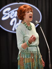 "Louise Morton sings, ""Will You Still Love Me Tomorrow"" as she competes in the singing competition Senior Idol Friday morning at The Kitchen. This year's contest featured 13 vocalists."