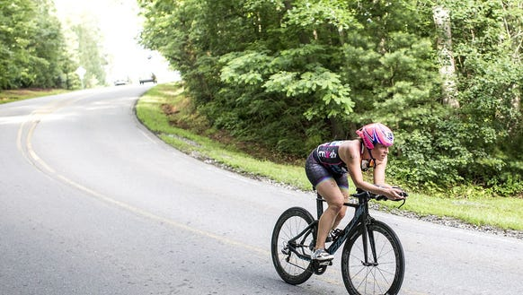 Female winner Maggie Rusch flies through the bike leg