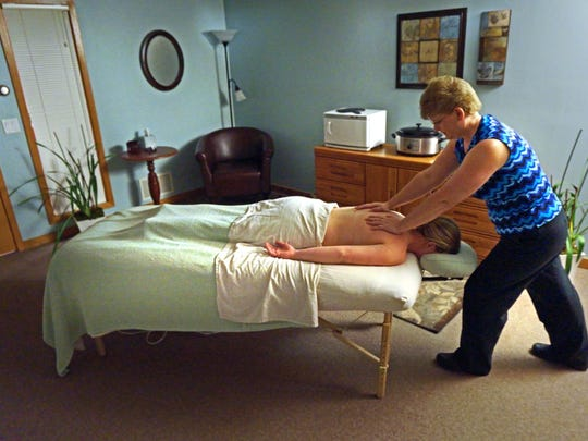 Kristine Ahles of Kneaded Relief works on a client.