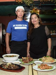Chef Sherwin Mia, left, and owner Vikki Fernandez, present some of their most popular dishes at V-Keys Lounge & Restaurant in Tamuning on Oct. 31.