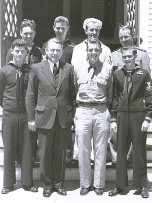 The Rev. Carl F. Schultz of the Hyannis Federated Church is pictured with local servicemen in this undated photograph. Dr. Schultz served as the church's pastor for 48 years, from 1926 to 1976.