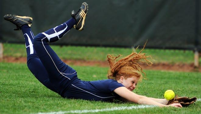 Enka right fielder Mariah Foxworth dives for a ball in Thursday's 9-8 win at Reynolds.