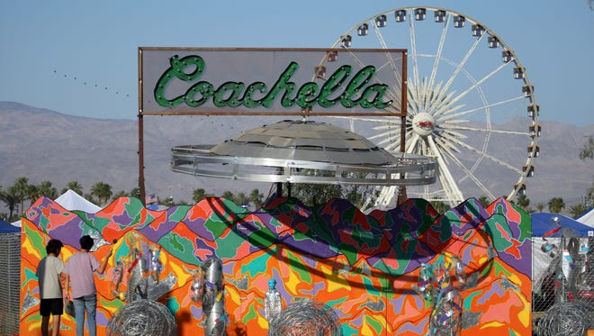 "Festival-goers view the ""Coachella Bound"" art installation at the campgrounds at The Coachella Music and Arts Festival April 19, 2015, in Indio, Calif."