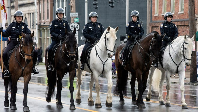 Members of the LMPD mounted patrol unit help start the 2017 Pegasus Parade on Thursday. 5/4/17