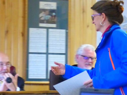 Shippen Salas, director of the Ski Apache Adaptive Sports, receives a proclamation from the mayor of Ruidoso.