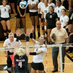Volleyball, Purdue vs Austin Peay.  Coach Dave Shondell and the rest of team look on as Sam Epenesa tips the ball.