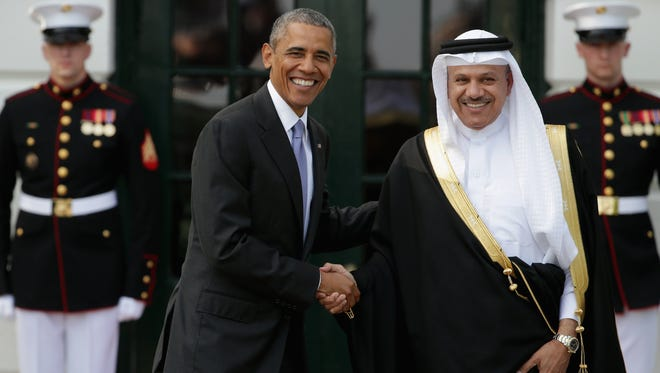 President Obama welcomes Abdul Latif bin Rashid Al Zayani, secretary general of the Gulf Cooperation Council, to the White House on May 13, 2015.