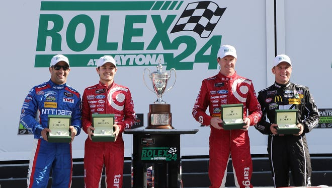 Chip Ganassi Racing drivers (from left to right) Tony Kanaan, Kyle Larson, Scott Dixon and Jamie McMurray receive their Rolex watches after winning the 2015 Rolex 24 at Daytona.