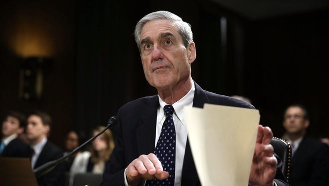 Robert Mueller waits for the beginning of a hearing before the Senate Judiciary Committee on June 19, 2013.