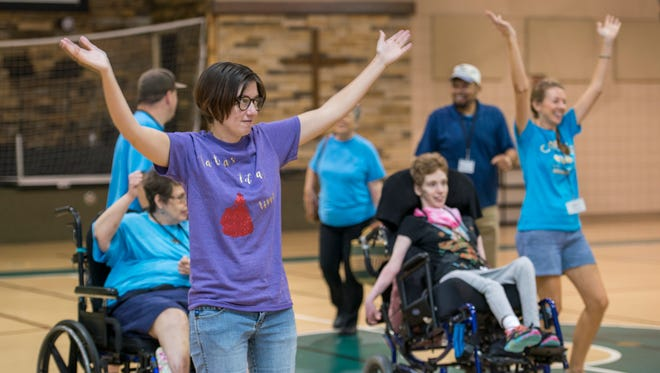 Erin Weiler, left, and others dance during the respite program at the Community Life United Methodist Church in Gulf Breeze on Thursday, Sept. 28, 2017.
