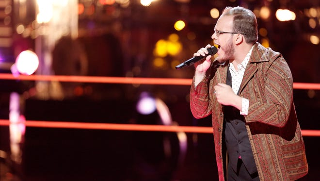 "Lansing native Lucas Holliday was eliminated during the first round of knockouts on ""The Voice"" Monday night."