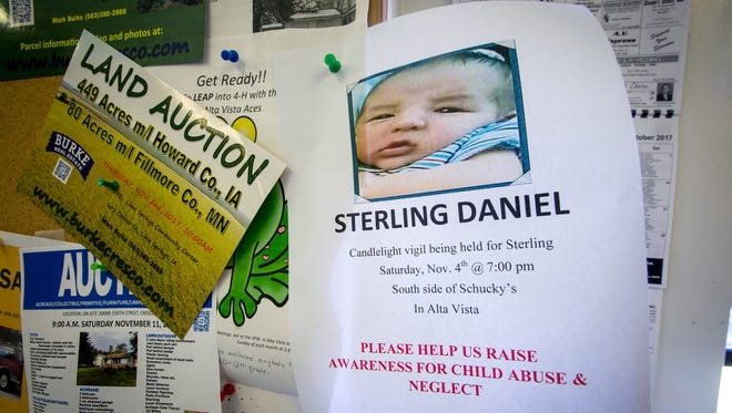 A flyer pinned Oct. 31, 2017, on a bulletin board in an Alta Vista, Iowa, convenience store tells of a Nov. 4 candlelight vigil for a 4-month-old whom state officials say died because of parental neglect.