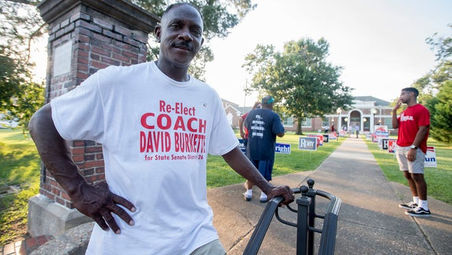David Burkette checks in at the polling place in Cloverdale just before the polls close in Montgomery, Ala. on Tuesday July 17, 2018.