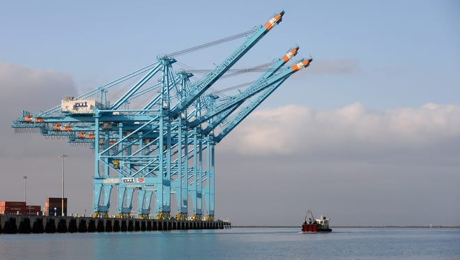 Container cranes stand in the Port of Los Angeles on April 16, 2013 in San Pedro, California.