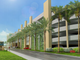 A conceptual rendering shows the parking garage opposite