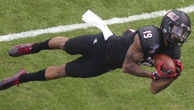 Northern Illinois' Kenny Golladay makes a diving catch near the end zone, but is unable to complete the catch in the first quarter against Boise State during the Poinsettia Bowl at Qualcomm Stadium in San Diego on Wednesday, Dec. 23, 2015.