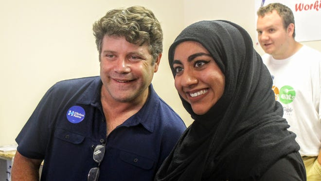 Actor Sean Astin poses for a photo with Canton resident Ammara Ansari at the Livonia Democratic coordinated campaign office Wednesday.